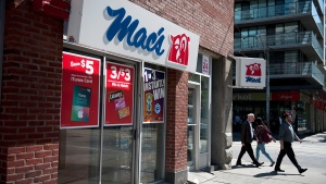 People walk by a Mac's convenience store in Toronto, Tuesday, Sept, 22, 2015. (Marta Iwanek / THE CANADIAN PRESS)