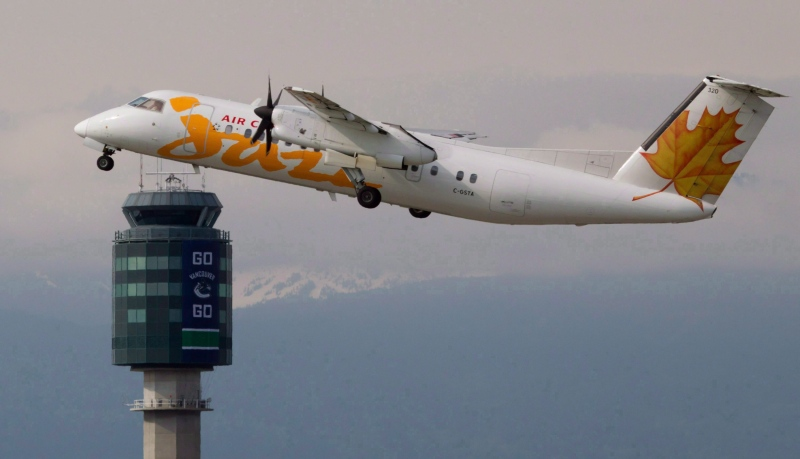 An Air Canada Jazz De Havilland DHC-8 takes off at Vancouver International Airport in Richmond, B.C., in this file photo taken on May 30, 2011. (Darryl Dyck/THE CANADIAN PRESS)