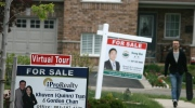 For sale signs are seen in Oakville, Ont., on Friday, May 22, 2015. (THE CANADIAN PRESS IMAGES/Richard Buchan)