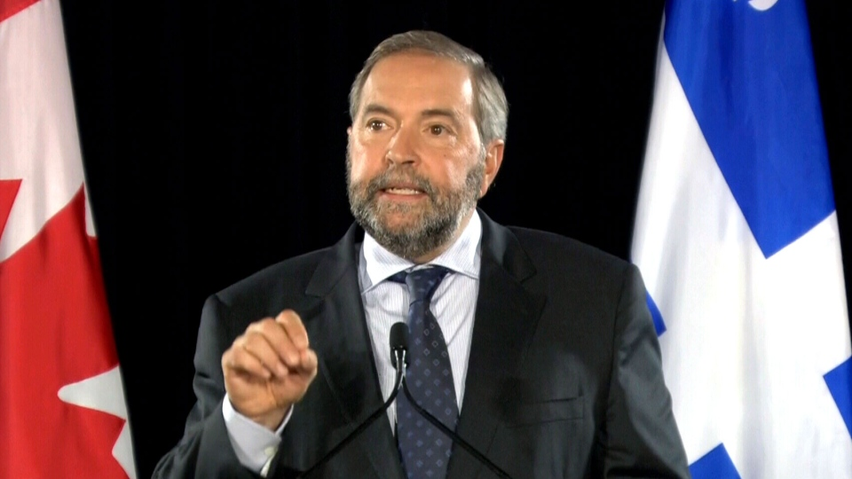 NDP Leader Tom Mulcair delivers a speech at Marche Bon Secours in Montreal, Wednesday, Sept. 23, 2015.