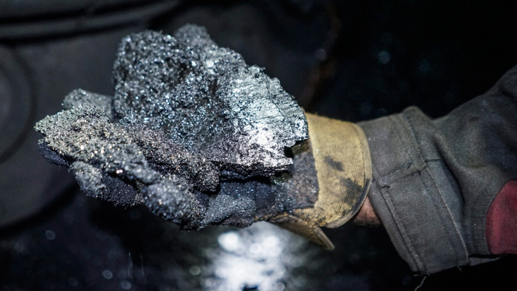 A miner shows a lump of coal