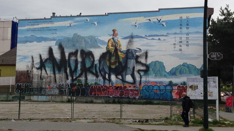 A $18,000 mural in Vancouver's Chinatown depicting the founder of Taoism has been vandalized. (Nafeesa Karim/CTV)