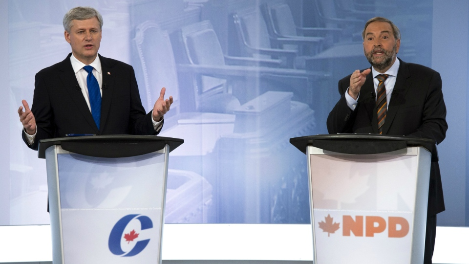 Conservative Leader Stephen Harper, left, exchanges words with NDP Leader Tom Mulcair during the French-language debate in Montreal on Sept. 24, 2015. (Adrian Wyld / THE CANADIAN PRESS)