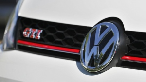 The grille of a Volkswagen car for sale is decorated with the iconic company symbol at a VW dealership in Boulder, Colo. on Sept. 24, 2015. (AP / Brennan Linsley)