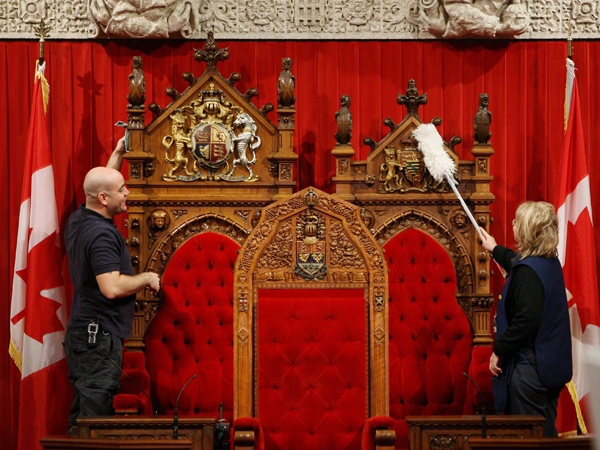 Marie-Rose Angers, left, and Kevin Larocque clean the the Senate Chamber on Parliament Hill in Ottawa on Monday, Nov. 17, 2008.  (Sean Kilpatrick / THE CANADIAN PRESS)