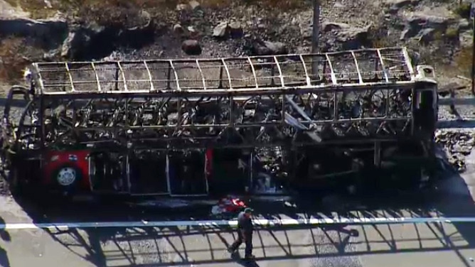 A burned bus is seen from the CTV News chopper on Friday, Sept. 25, 2015.