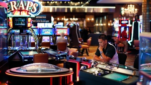 In this Sept. 24, 2015, photo, a man plays an electronic roulette game at the Downtown Grand hotel and casino in Las Vegas. (John Locher / THE ASSOCIATED PRESS)