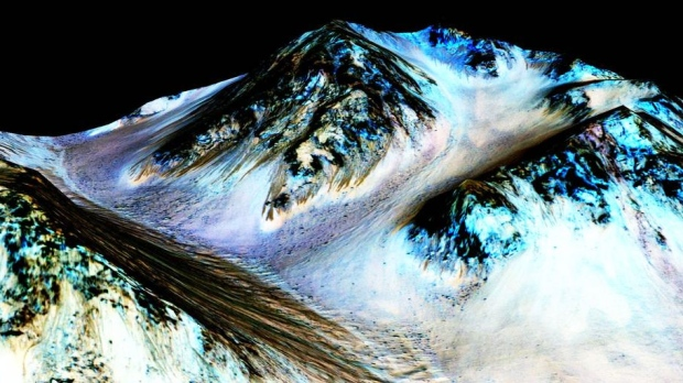 NASA announced that these dark, narrow, 100 metre-long streaks called recurring slope lineae flowing downhill on Mars are inferred to have been formed by contemporary flowing water on Monday, Sept. 28, 2015. (NASA / JPL / University of Arizona)
