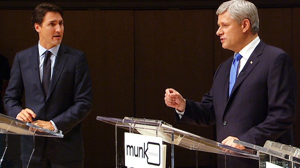 Liberal Leader Justin Trudeau and Conservative Leader Stephen Harper speak at an election leaders' debate, in Toronto, Monday, Sept. 28, 2015.