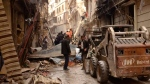 In this April 11, 2015 file photo, released by the Syrian official news agency SANA, Syrians gather between damaged buildings in the predominantly Christian and Armenian neighborhood of Suleimaniyeh, Aleppo, Syria. The country has already been shattered by more than four years of civil war, and with no solution in sight some players on the ground and observers outside have concluded its fate will be to break up along sectarian or regional lines, in a best-case scenario, tenuously held together by a less centralized state. (SANA via AP, File)