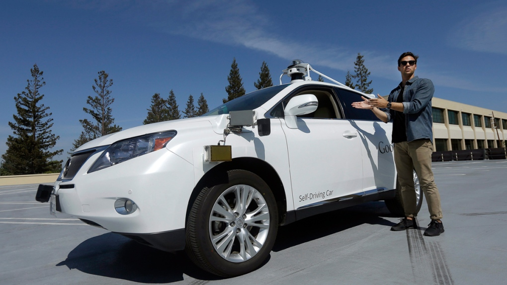 Brian Torcellini with a self-driving car