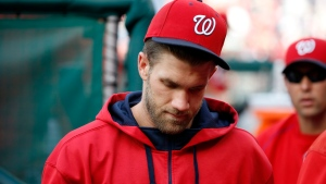 Washington Nationals right fielder Bryce Harper walks in the dugout in Washington, on Monday, Sept. 28, 2015. (AP Photo/Alex Brandon)