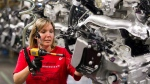 Engine Specialist Jennifer Souch assembles a Camaro engine at the GM factory in Oshawa, Ont.  on Friday, June 10, 2011. (Frank Gunn / THE CANADIAN PRESS)