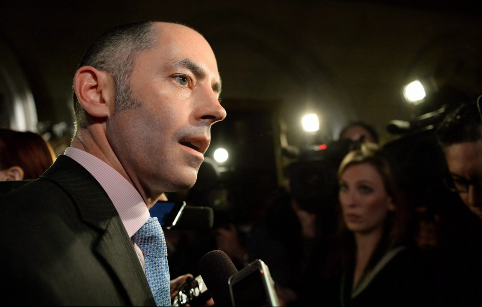 Prime Minister Stephen Harper's then-director of communications Jason MacDonald speaks to reporters in the foyer of the House of Commons on Parliament Hill in Ottawa on Nov. 20, 2013. (Sean Kilpatrick / THE CANADIAN PRESS)