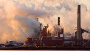 Steel plants are seen across the bay at sunrise in Hamilton, Ont. Wednesday Feb. 7, 2007 (Adrian Wyld / THE CANADIAN PRESS)