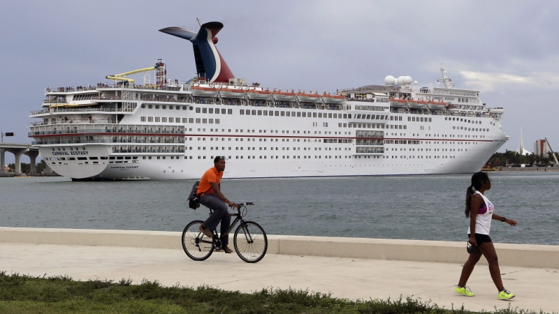 In this Friday, July 24, 2015 photo, the Carnival Ecstasy cruise ship leaves the Port of Miami. (AP/Lynne Sladky)