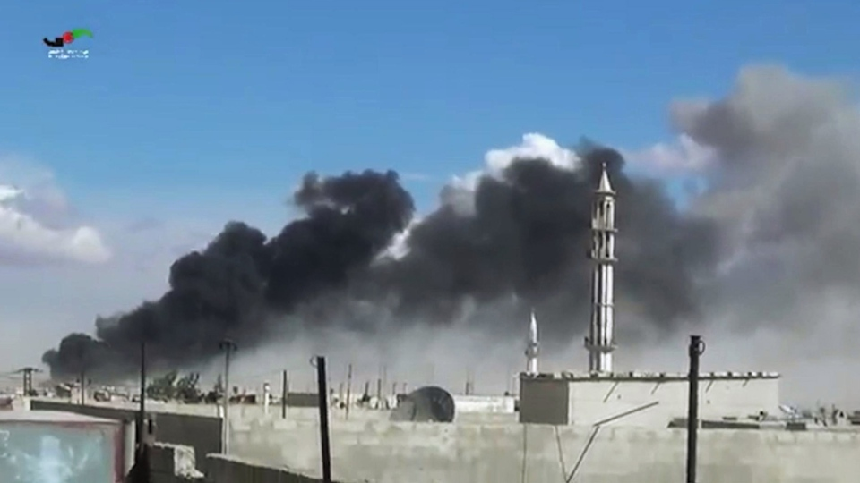 In this image made from video provided by Homs Media Centre, which has been verified and is consistent with other AP reporting, smoke rises after airstrikes by military jets in Talbiseh of the Homs province, western Syria, Wednesday, Sept. 30, 2015. (Homs Media Centre via AP)