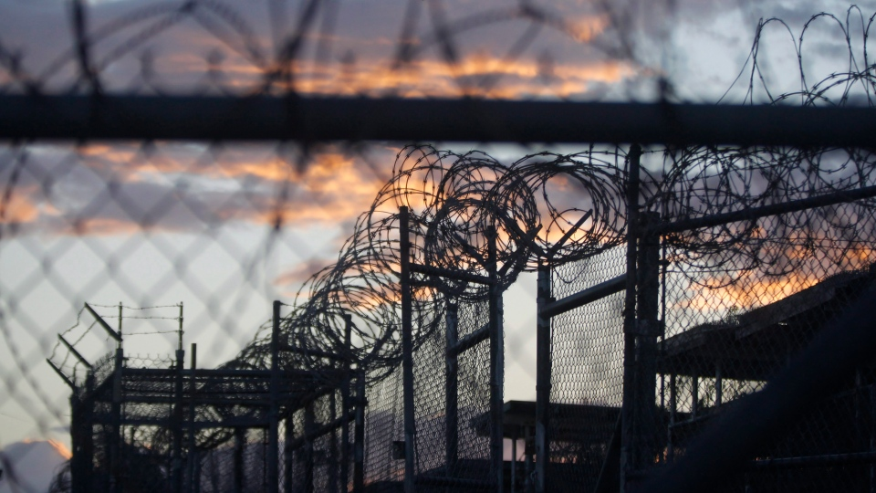 In this Nov. 21, 2013 photo, dawn arrives at the now closed Camp X-Ray, which was used as the first detention facility for suspected militants captured after the Sept. 11 attacks, at the Guantanamo Bay Naval Base in Cuba. ( Charles Dharapak / AP Photo)