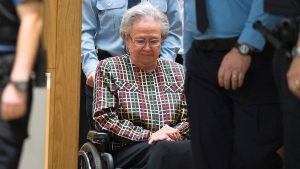 Former Quebec lieutenant governor Lise Thibault is escorted by agents, leaving the courtroom after receiving an 18-month prison sentence at the courthouse in Quebec City, Wednesday, Sept. 30, 2015. (Jacques Boissinot / THE CANADIAN PRESS)