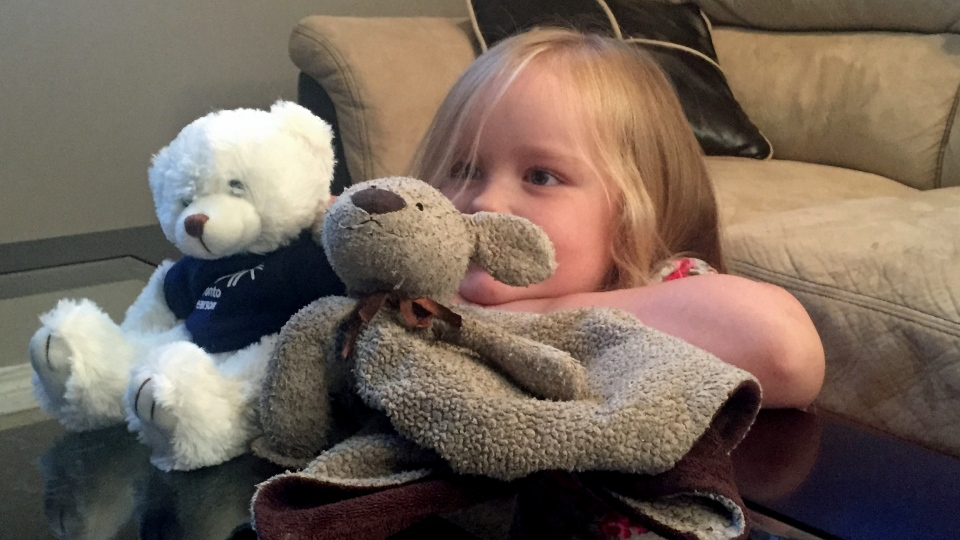 Four-year-old Phoebe Steel holds her favourite stuffed animal, Ra Ra, and new teddy bear, Pearson. Phoebe lost Ra Ra at the Toronto Pearson International Airport, but was recently reunited with the toy thanks to helpful staff.