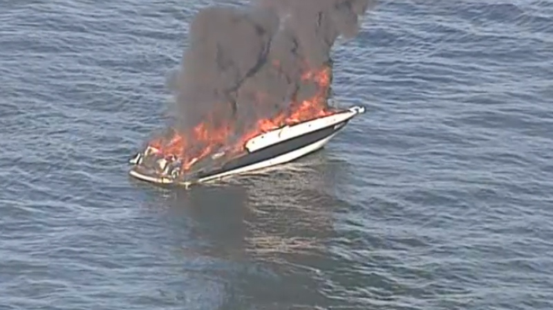 Two boaters are lucky to be alive after their craft burst into flames in the waters off Wreck Beach on Sept. 30, 2015. (Chopper 9)