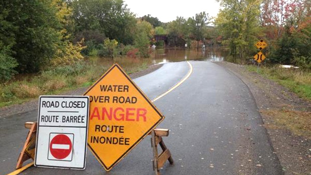 Bridge St. in Fredericton, N.B., is closed due to rising level of Nashwaak River, Thursday, Oct. 1, 2015. (Andy Campbell / CTV News)