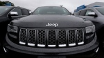 In this Oct. 1, 2014 file photo, rain drops rest on the hood of a Jeep Grand Cherokee at Bill DeLuca's dealerships in Haverhill, Mass. (AP Photo/Charles Krupa)