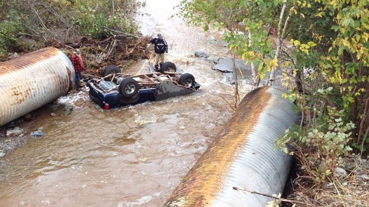 The driver of this truck suffered only minor injuries when he hit a washed out section of a highway in New Brunswick Thursday, Oct. 1, 2015. (Andy Campbell / CTV News)