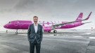 Skuli Mogensen, founder and CEO WOW air, Iceland's only ultra low-cost airline, is seen with one of his company's aircraft. (CNW Group/WOW air)