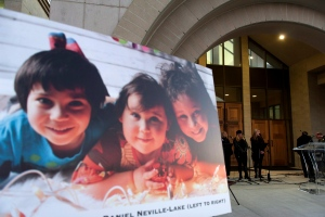 A photo of the Neville-Lake children, killed in a fatal car crash, is seen as people gathered for a candlelight vigil at St. Padre Pio Church in Kleinburg, Thursday, Oct, 1, 2015. (Marta Iwanek / THE CANADIAN PRESS)