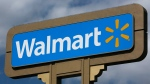 A sign is seen outside a Wal-mart store in Duarte, Calif. on May 28, 2013. (AP Photo/Damian Dovarganes)