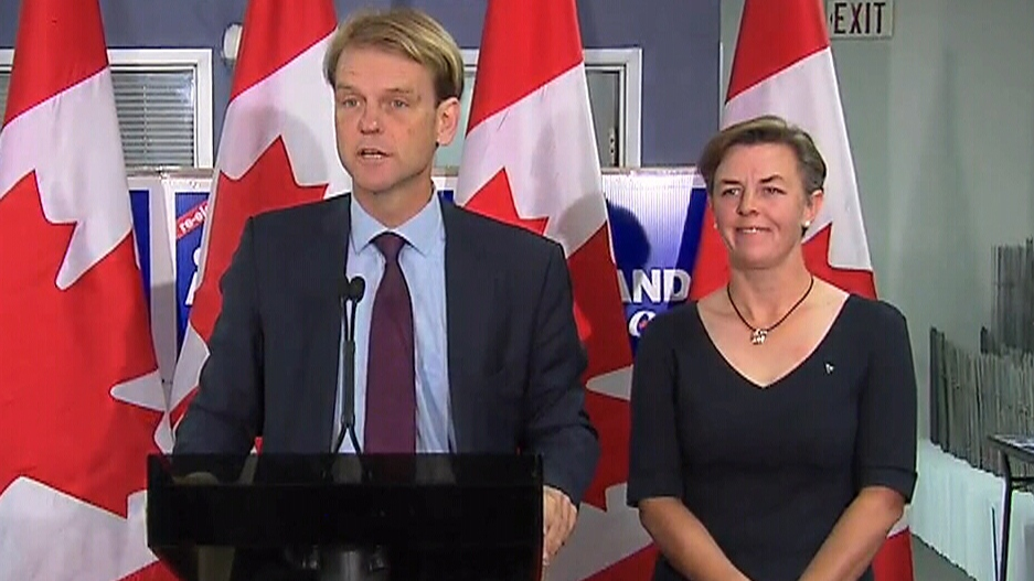 Conservative Party candidates Chris Alexander, left, and Kellie Leitch speak in Ajax, Ont., on Friday, Oct. 2, 2015.