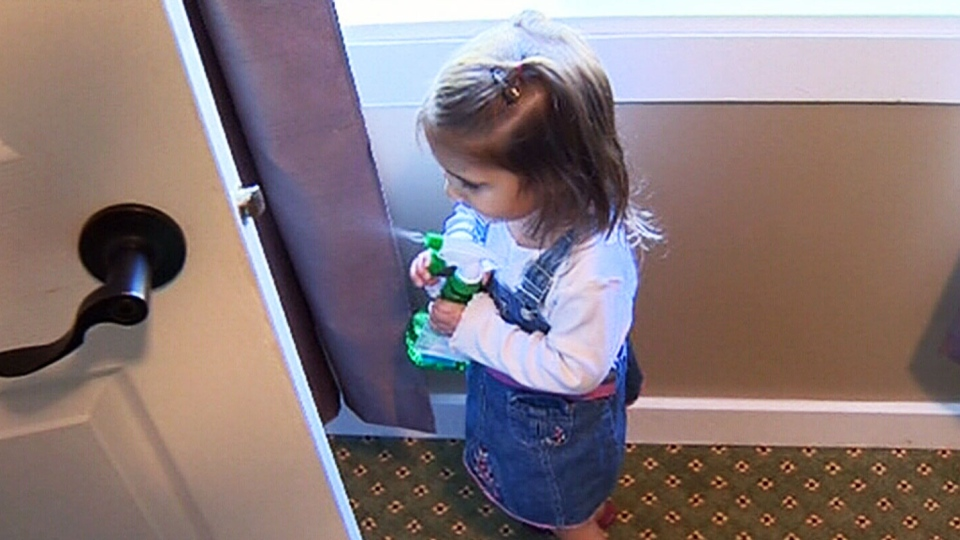 Mya Watson uses her 'monster spray' to get rid of monsters in her closet.
