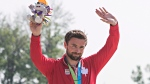 Canada's Mark Oldershaw accepts his silver medal for the C1 1000m at the 2015 Pan Am Games in Welland, Ont., Monday, July 13, 2015. (THE CANADIAN PRESS/Aaron Lynett)