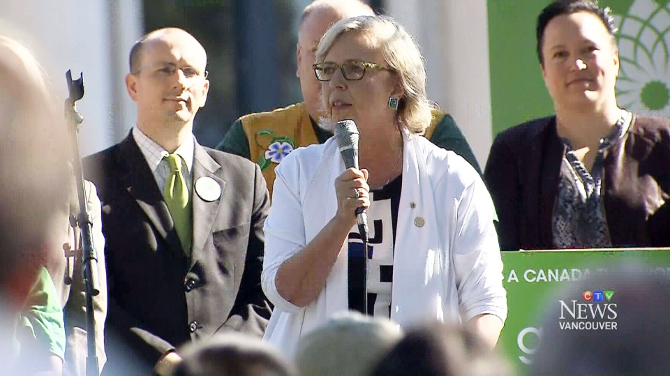 Green Party Leader Elizabeth May welcomed former federal scientist Tony Turner to retirement by bringing him on stage at a Vancouver campaign rally to sing his viral folk song 'Harperman.'