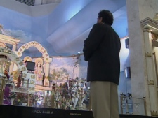 An Indian man prays for a relative in India, at the Hindu Sabha Temple in Brampton, Ont., on Wednesday, Nov. 27, 2008.