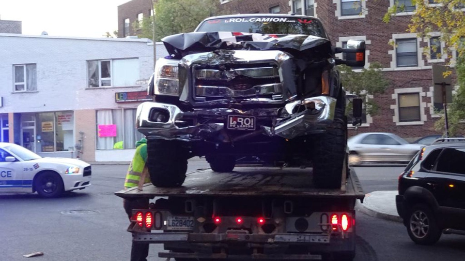 A truck is prepped to be towed away from the scene of a collision involving Montreal Canadiens winger Zack Kassian Sunday, Oct. 4 2015. Kassian, the female driver and a female passenger all sustained non-life-threatening injuries in the crash. (Twitter/@stevenp57)