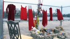Red dresses at Tina Fontaine memorial site