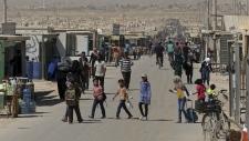Syrian refugees returning home