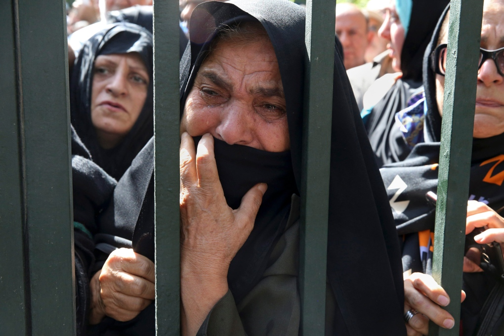 An Iranian mourner weeps during a funeral ceremony