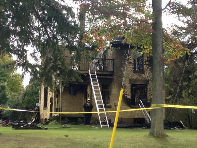 An investigation is underway after the roof of a farmhouse collapsed in a weekend fire near Strathroy, Ont. on Monday, Oct. 5, 2015. (Colleen MacDonald / CTV London)