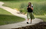 In this photo taken Aug. 28, 2015, Bethany Hughes walks through a park in Kansas City, Mo. as she prepares for her upcoming hike through the Americas. (AP/Charlie Riedel)