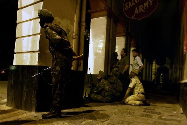 Indian soldiers keep watch on the Taj Mahal hotel where gunmen are holed up in Mumbai, India, on Friday, Nov. 28, 2008. (AP / Altaf Qadri)