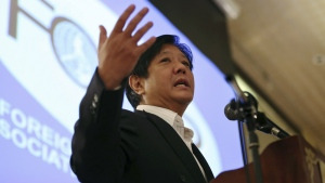 Sen. Ferdinand 'Bongbong' Marcos Jr. gestures during his speech as he talks about the Bangsamoro Basic Law during the Foreign Correspondents Association of the Philippines meeting in Manila, Philippines on Feb. 11, 2015. (AP / Aaron Favila)