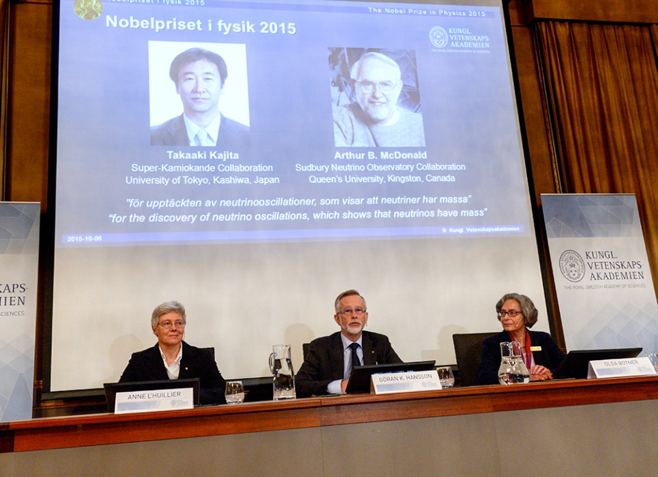 Professors Anne L'Huillier, left, Goran K. Hansson and Olga Botner, right, members of the Nobel Assembly announce the winner of the 2015 Nobel Prize in physics, in Stockholm, Tuesday Oct. 6, 2015. (Fredrik Sandberg / TT)