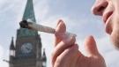 A man is seen smoking marijuana on Parliament Hill in Ottawa, on April 20, 2010. (Pawel Dwulit / THE CANADIAN PRESS)