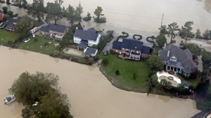 Floodwaters close in on homes on a small piece of land on Lake Katherine in Columbia, S.C., Monday, Oct. 5, 2015. (AP / Chuck Burton)