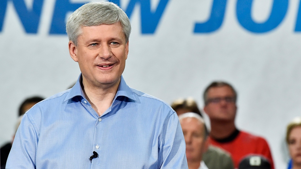 Conservative Leader Stephen Harper speaks during a campaign stop at Global Systems Emissions Inc., in Whitby, Ont., on Tuesday, Oct. 6, 2015. (Nathan Denette / THE CANADIAN PRESS)
