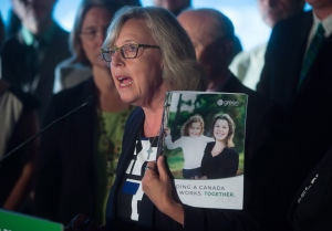 Green Party Leader Elizabeth May holds a copy of her party's platform during a campaign event in Vancouver, B.C., on Wednesday September 9, 2015. A federal election will be held October 19. (Darryl Dyck/THE CANADIAN PRESS)