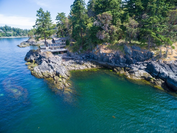 Nestled in the waters off B.C.'s Sunshine Coast, this six-acre secluded island boasts ocean views and is only a half hour from downtown Vancouver. The property boasts a luxury home with nearly 2,500 square feet of decks and viewing areas – perfect for whale watching (Sotheby's International Realty Canada/Shaz Karim).
